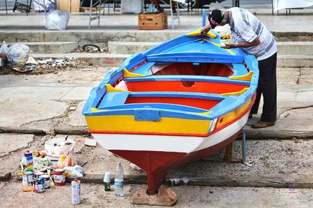 mondello: Mondello, May 15: Fisherman prepares his boat before a fishing trip in Mondello, Palermo, May 15, 2010