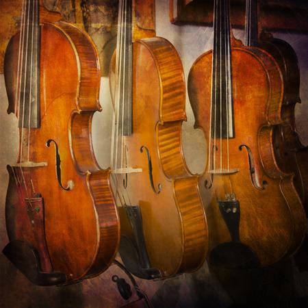 violins: Violins on grunge backgroun Stock Photo