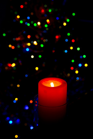 Christmas candle on the background the Christmas tree photo