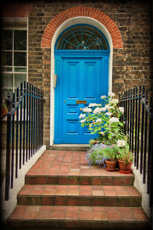 London, entrance to a house with flower beds full of flowers Stock Photo