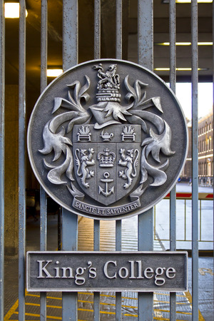 Honorific emblem on the entrance gate of King's College in London, public view from street