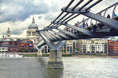 millennium bridge: LONDON, AUGUST 3, 2010: Beautiful view of Millennium Bridge, Saint Paul Cathedral on background, London, UK Editorial