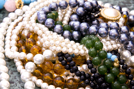 Closeup, necklaces with colored stones, jewelry, bijouteria photo