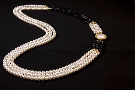 black onyx: Necklace of pearls on black background
