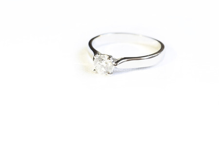 Ring with diamond on the white background