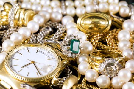 Closeup of gold jewelery with precious stones Stock Photo