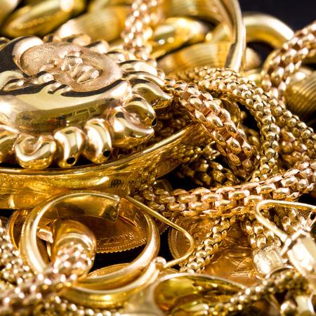 Closeup of yellow gold jewelery on a black background  Stock Photo