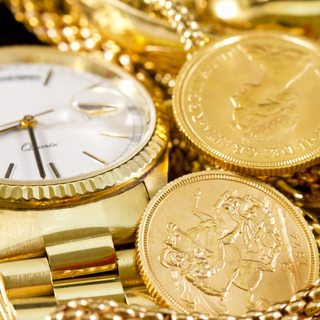 Jewelry, gold, necklaces, rings, bracelets, watch, wealth Stock Photo - 28056604
