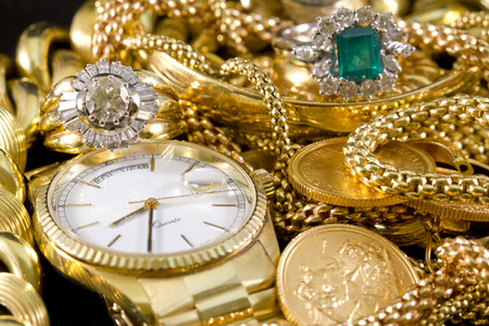 Closeup of gold jewelery with precious stones Imagens