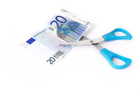 Cutting one banknote with scissors