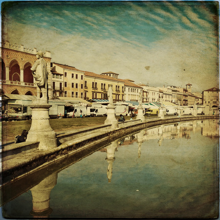 View of the canal with statues on Prato della Valle in Padova, Veneto, Italy. Texture retro photo