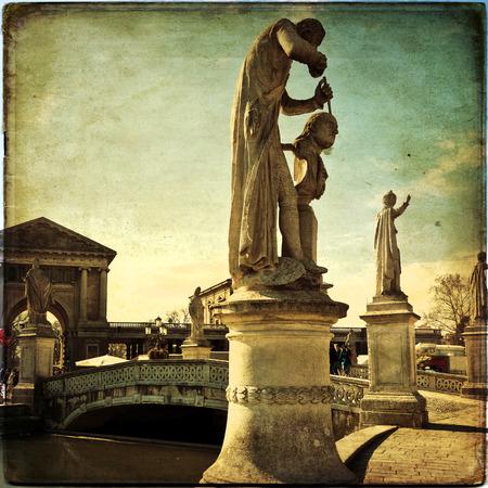 View of the canal with statues on Prato della Valle in Padova, Veneto, Italy. Texture retro photo