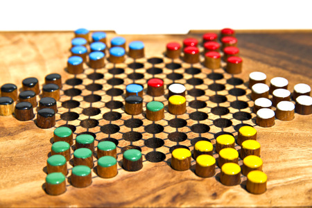 Chinese checkers wooden on the white background Stock Photo