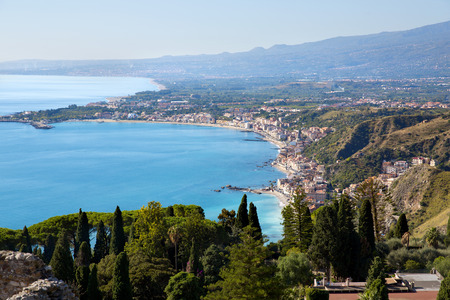 Traditional Sicilian village Taormina with view on Etna volcano photo