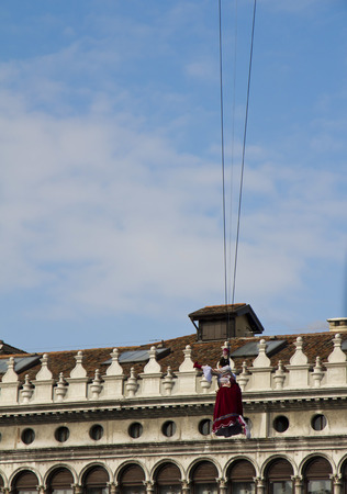 st mark's square: VENICE, ITALY, FEBRUARY 23, 2014: Carnival of Venice. Flight of the dove from the bell tower of St. Marks Square in Venice, opening of the Carnival