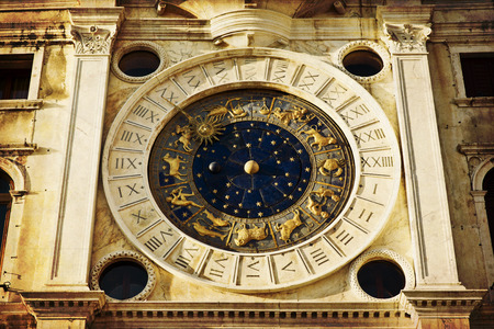 clock of the moors: Zodiac clock. Clock Tower with winged lion and two moors striking the bell - early Renaissance (1497) building in Venice, located the north side of Piazza San Marco, Italy, Europe Stock Photo
