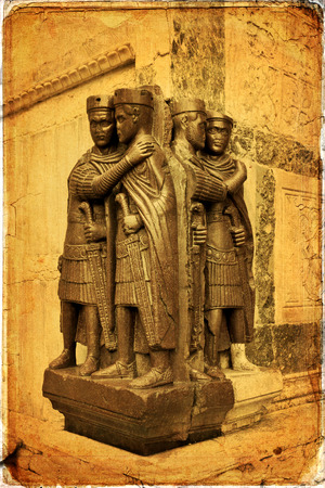 kinship: A porphyry statue of the first Roman Tetrarchy stolen from Constantinople during the Fourth Crusade, and now embedded in an external wall of the Basilica di San Marco, Venice, Italy Stock Photo