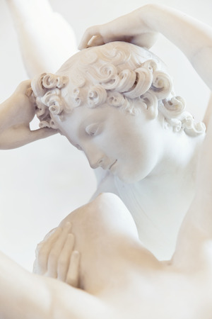 psyche: PARIS, FRANCE, August 6, 2014  The kiss of Eros and Psyche by Canova, at the Louvre in Paris, France  Editorial