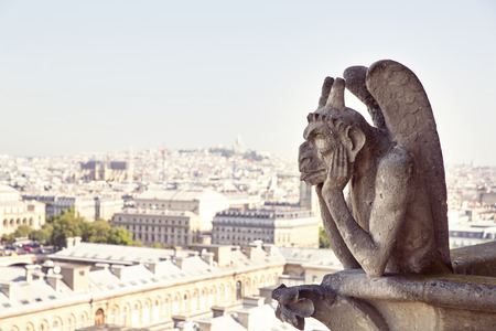Notre Dame of Paris  Famous Chimera, demon, overlooking the Eiffel Tower at a summer day Stock Photo
