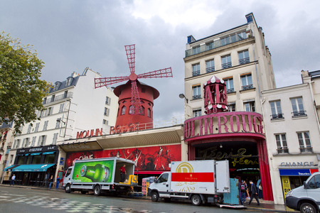 locating: PARIS - AUGUST 8: The Moulin Rouge on August 8, 2014 in Paris, France. Moulin Rouge is a famous cabaret built in 1889, locating in the Paris red-light district of Pigalle