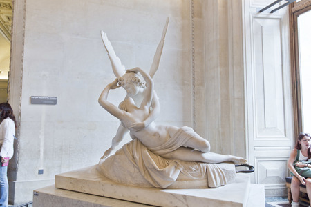 eros: PARIS, FRANCE, August 6, 2014: The kiss of Eros and Psyche by Canova, at the Louvre in Paris, France