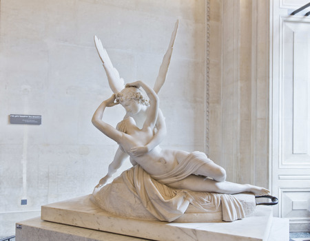 PARIS, FRANCE, August 6, 2014: The kiss of Eros and Psyche by Canova, at the Louvre in Paris, France