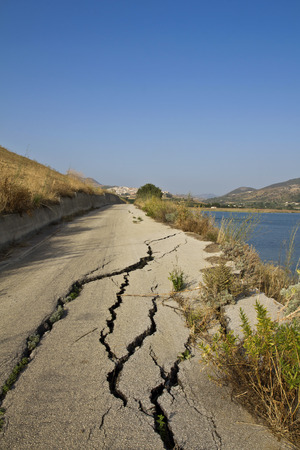 Road destroyed by a landslide in Sicily Stock Photo