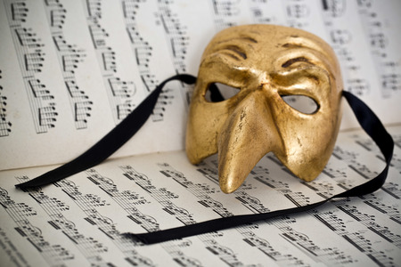 Beautiful carnivale mask from venice Italy, on a sheet of music photo