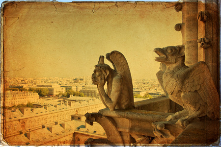 Notre Dame of Paris: Famous Chimera, demon, overlooking the Eiffel Tower at a summer day in vintage style