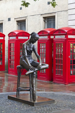coven: Traditional old style UK red phone boxes in London in Coven Garden