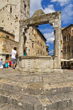 durability: SAN GIMIGNANO, ITALY, August 7, 2011: Tourists in San Gimignano, Italy. UNESCO declared the town a World Heritage Site.