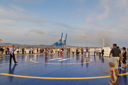 helicopter pad: CIVITAVECCHIA, ITALY, August 14, 2011: Tourists in Helipad for helicopter on the upper deck of big cruise ship Editorial