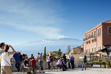 taormina: TAORMINA, SICILY, November 3, 2012: Traditional Sicilian village Taormina with view on Etna volcano
