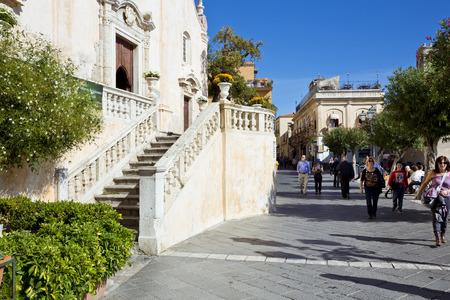 taormina: TAORMINA, SICILY, November 3, 2012: Tourists walking in Taormina