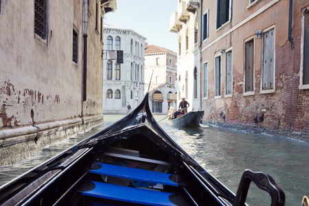 mode transport: On gondola on the Grand Canal in Venice. Gondolas are a major mode of touristic transport in Venice, Italy.