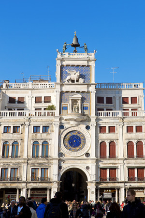 clock of the moors: Zodiac clock. Clock Tower with winged lion and two moors striking the bell - early Renaissance (1497) building in Venice, located the north side of Piazza San Marco, Italy, Europe Editorial