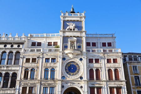 clock of the moors:  Clock Tower with winged lion and two moors striking the bell - early Renaissance (1497) building in Venice, located the north side of Piazza San Marco, Italy, Europe Stock Photo