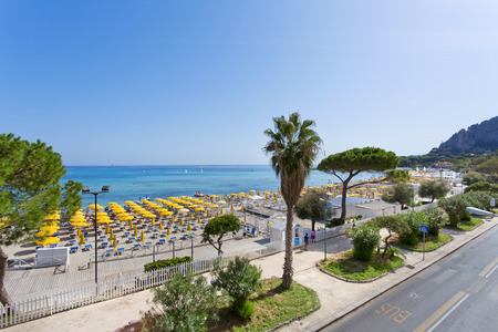 Mondello, Parasols on the beach. Mondello is one of the most popular destinations for a Sicilian vacation. Stock Photo