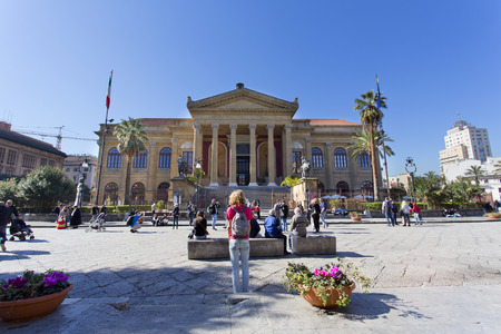 massimo: PALERMO, SICILY, February 2, 2016: tourists in front of famous opera house Teatro Massimo in Palermo, Italy.