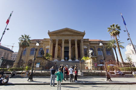 verdi: PALERMO, SICILY, February 2, 2016: tourists in front of famous opera house Teatro Massimo in Palermo, Italy.