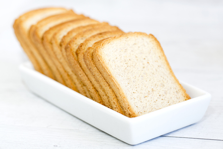 Rusks on a white platter and wooden background