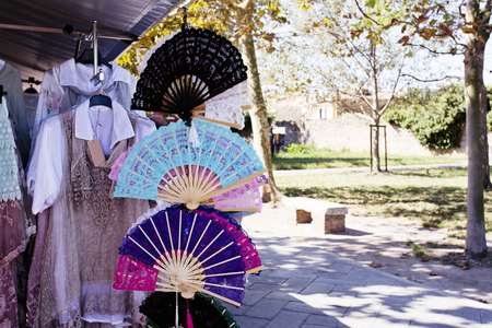 Different kinds of lace fans on sale in a street shop at Burano island, Venice, Italy