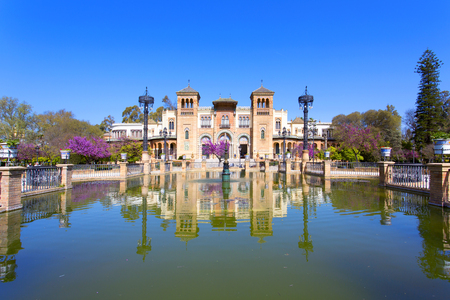 The mudejar pavilion and pond placed in the Plaza de America, houses the Museum of Arts and Traditions of Sevilla, Andalusia, Spain Editorial