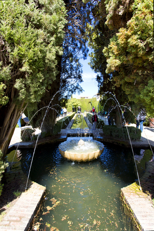 Close up of fountain in the famous avenue of cypress trees, Generalife gardens near Alhambra complex, Granada, Andalusia, Spain Editorial