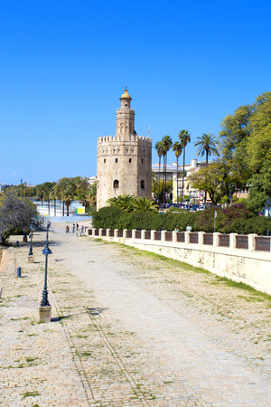 The famous Golden tower, Torre del Oro, along the Guadalquivir river, the Moorish tower built to defend Sevilla, Andalusia, Spain