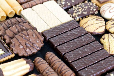 Glovebox with mixed chocolates of different flavors Stock Photo