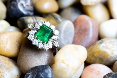 Closeup of gold jewelery with precious stones