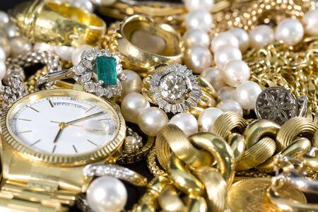 Closeup of gold jewelery with precious stones Фото со стока