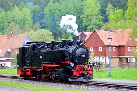 railtrack: 27 April 2014  Steam engine train - tourist steam train with black smoke running on the highway from Zittau to Oybin in the mountains in Saxony, Germany
