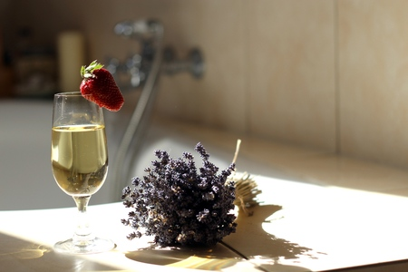 Luxury, relaxing bath with a glass of champagne photo
